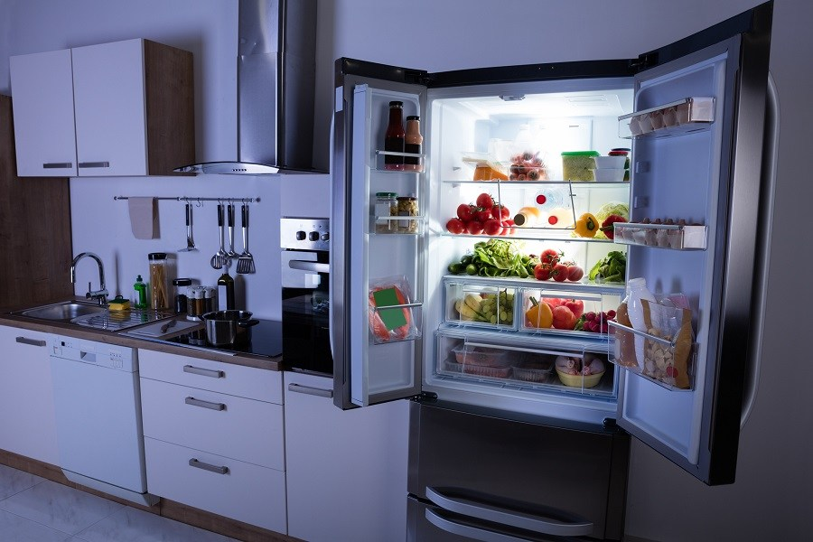 Refrigerator stocked with fresh produce