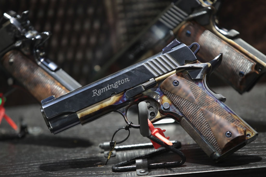 Custom Remington pistols are displayed at the 146th NRA Annual Meetings