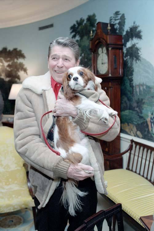 Ronald Reagan holding dog Rex