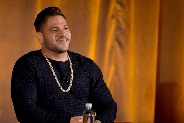 Ronnie Ortiz-Magro sitting in front of a yellow curtain.