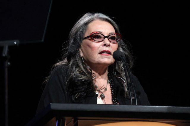 Roseanne Barr speaking at a podium.