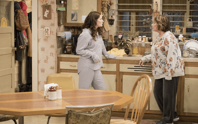 Roseanne speaks to her granddaughter in the kitchen.