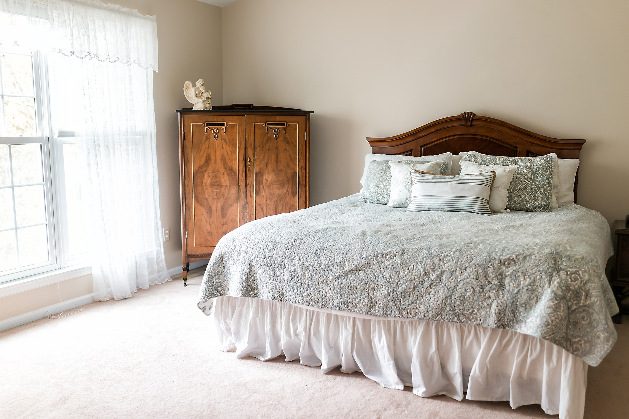 Dated bedroom with ruffle bed skirt