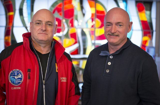 Scott Kelly standing next to his brother, Mark Kelly.