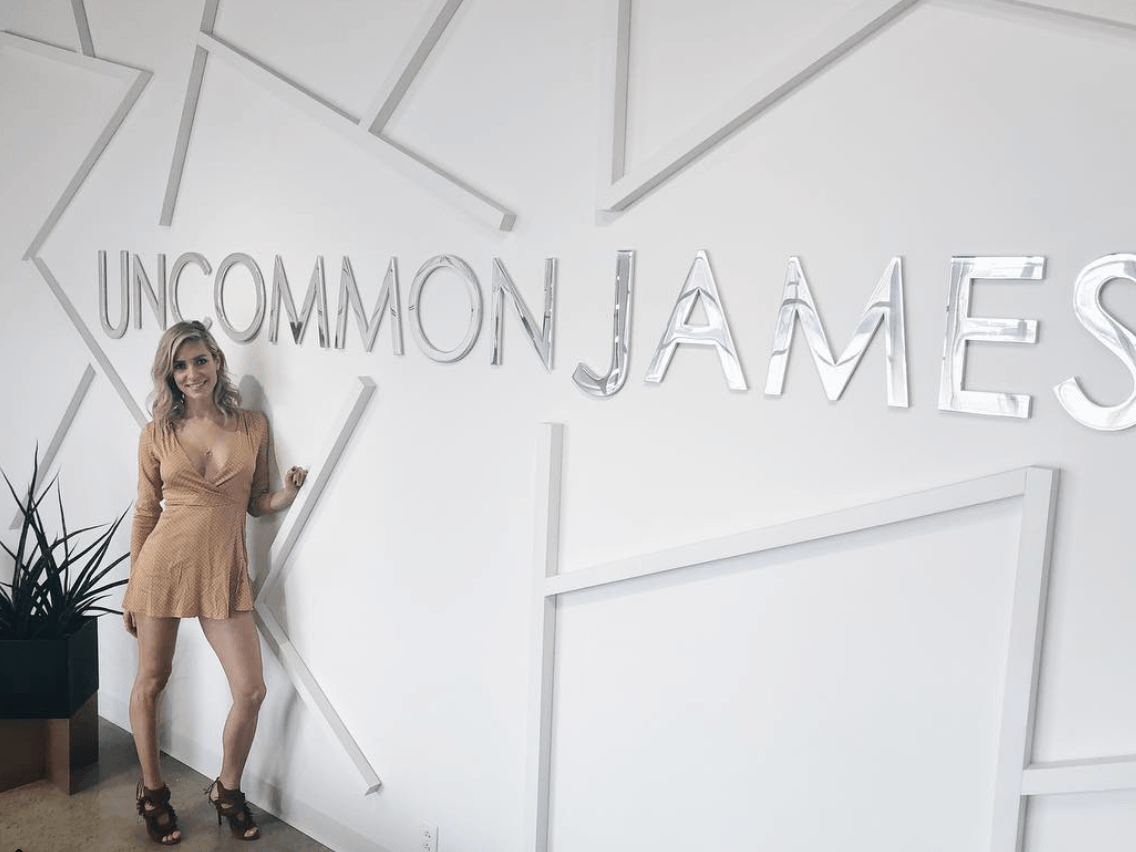 Kristin Cavallari in front of an Uncommon James sign