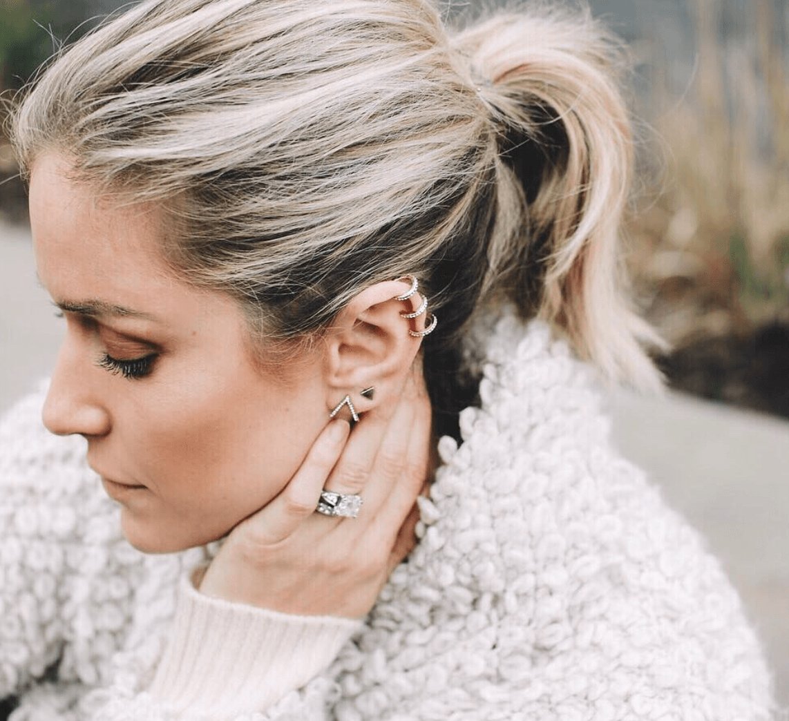 Kristin Cavallari' looks to the Side to show off her earrings