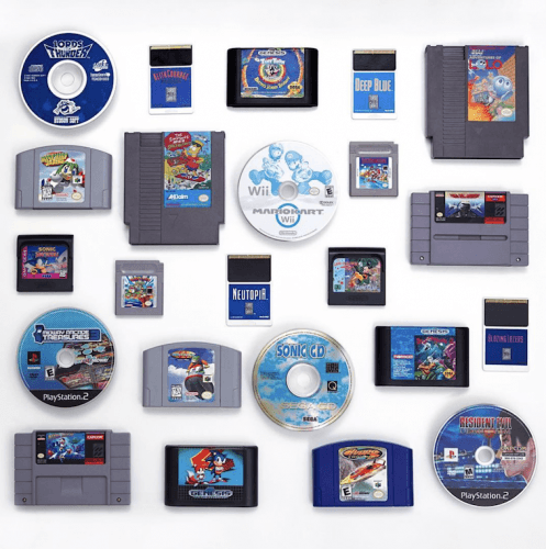 SEGA games laid out on a white table.