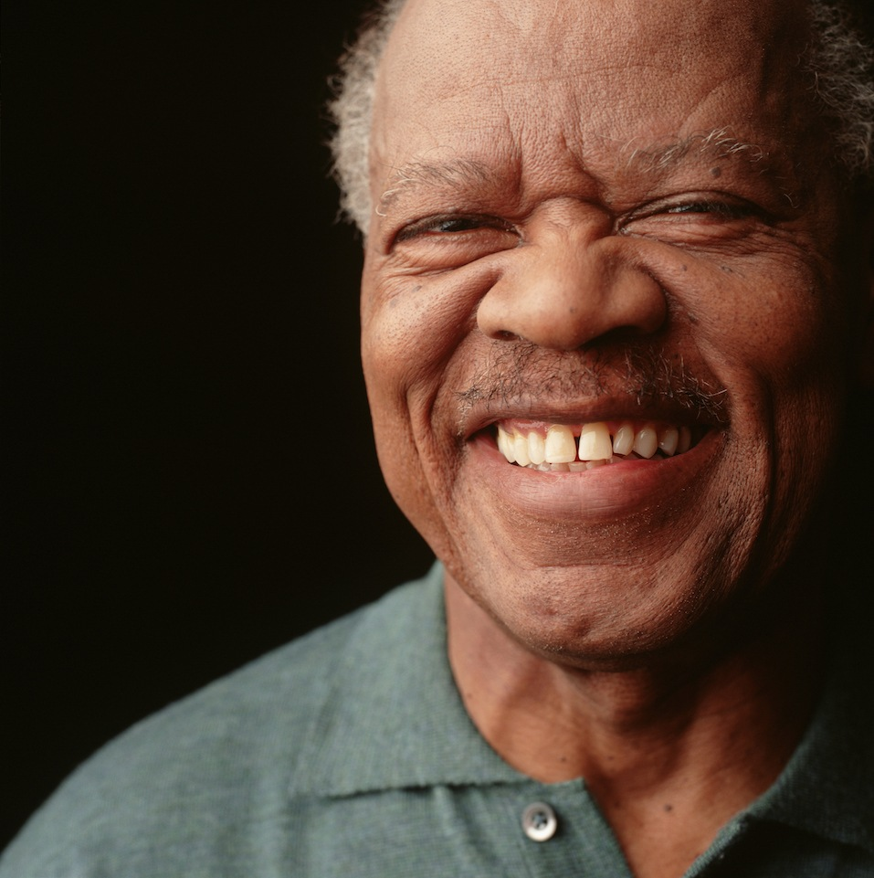 Senior man with moustache and toothy smile