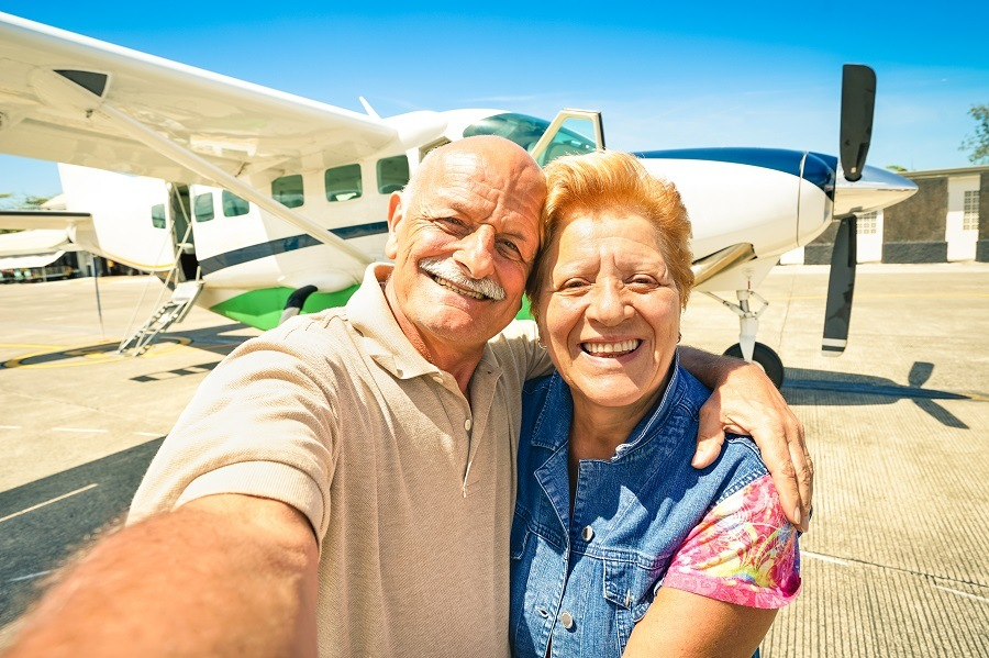 Old couple traveling