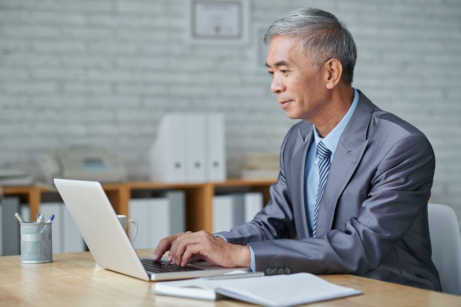 Senior working on computer