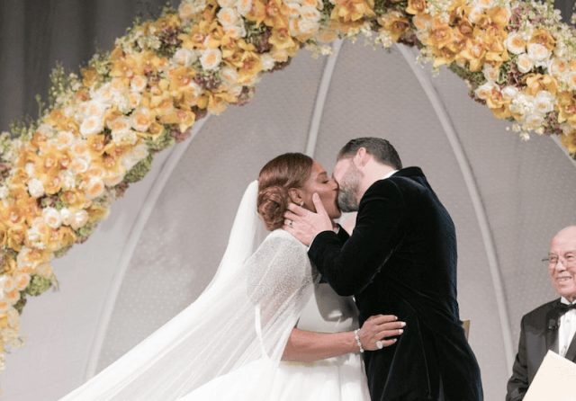 Serena Williams and Alexis Ohanian kiss on their wedding day.