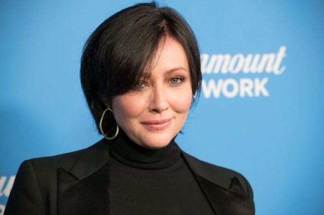 Shannen Doherty on a red carpet.