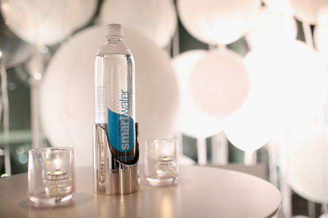 A bottle of smart water on a table.