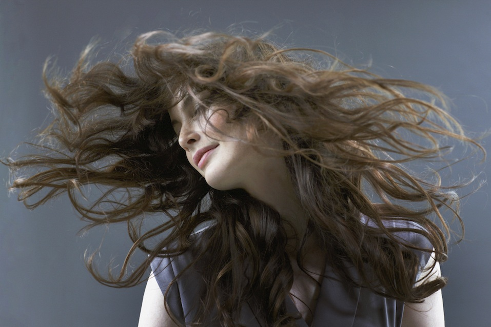 Smiling woman flipping hair