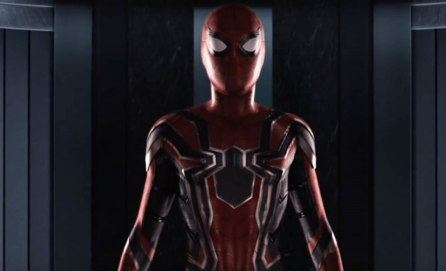 Spiderman suit being given to Peter.