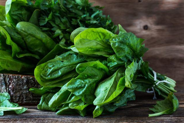 Spinach on a wooden table.