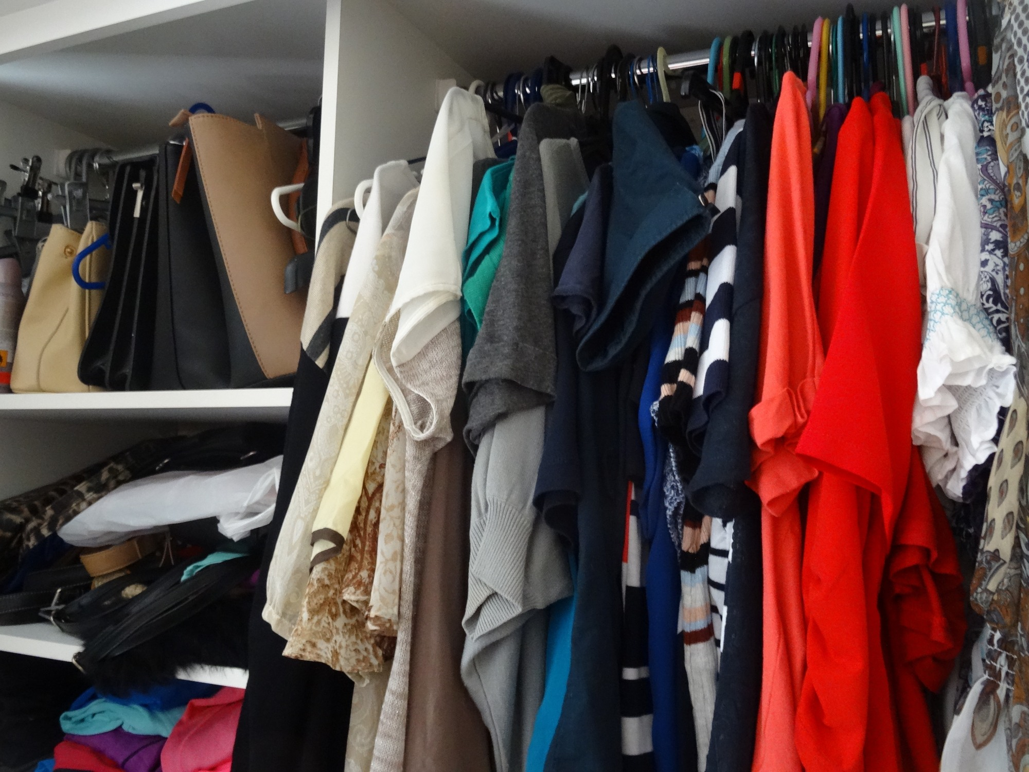 Overstuffed clothing in wardrobe or closet
