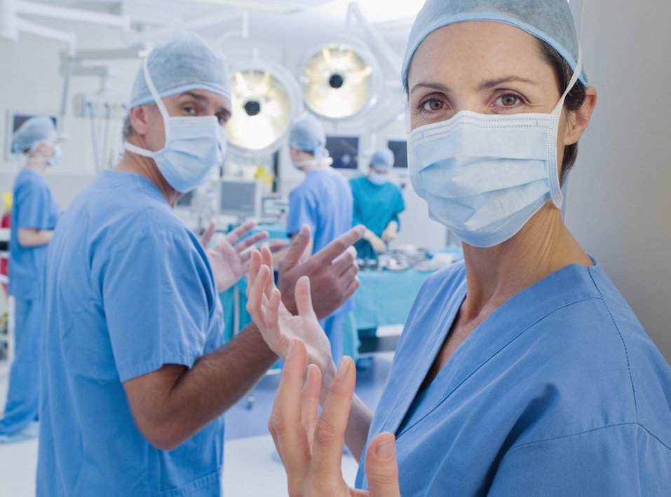 Surgeons with clean hands entering operating room