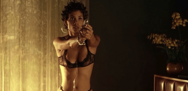 Halle Berry aiming a pistol in 'swordfish'.