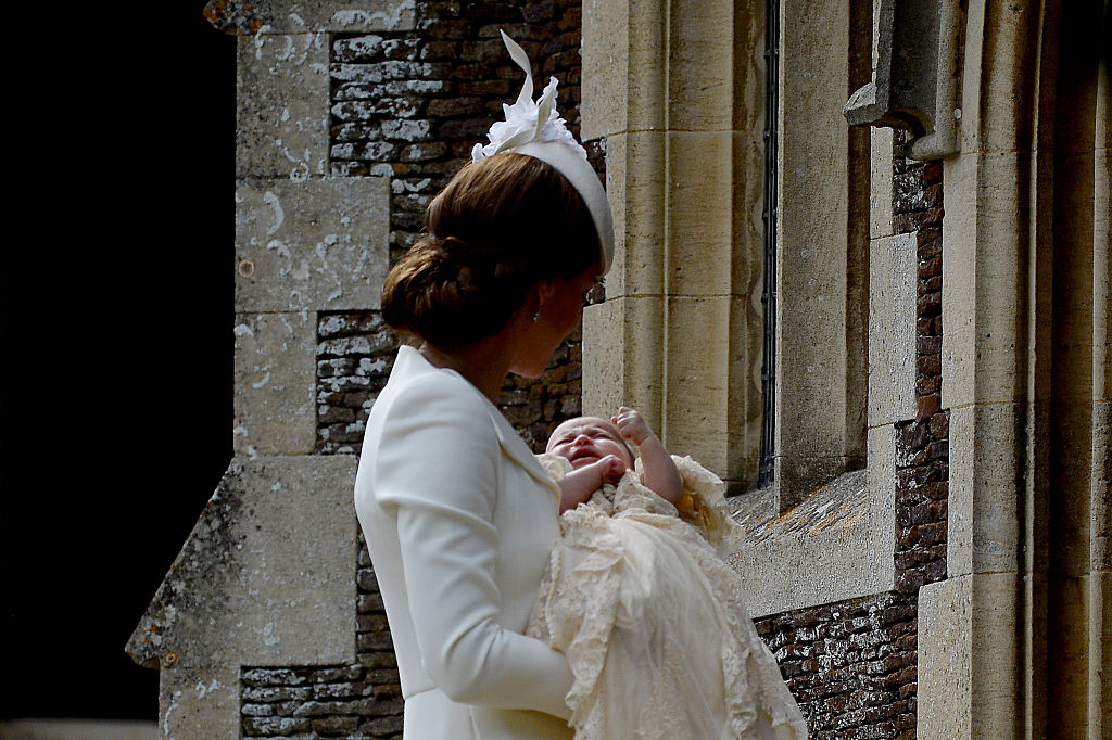 Catherine, Duchess of Cambridge and Princess Charlotte of Cambridge arrive at the Church of St Mary Magdalene on the Sandringham Estate for the Christening of Princess Charlotte of Cambridge