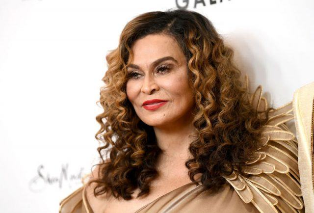 Tina Knowles-Larson poses on the red carpet in a nude gown.