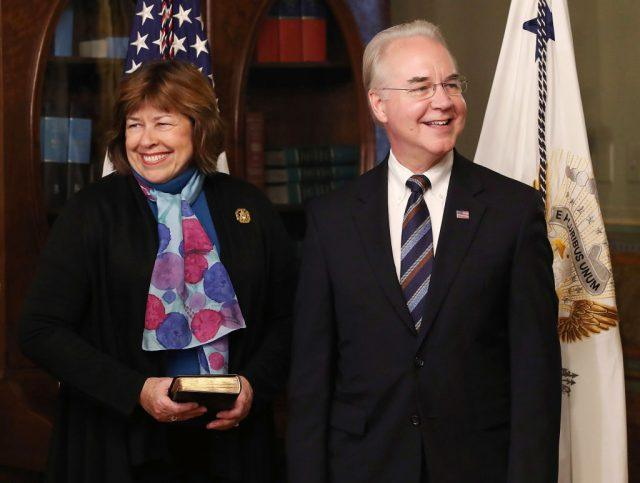 Tom Price) stands with his wife Betty Price before being sworn in as the new Health and Human Services Secretary,