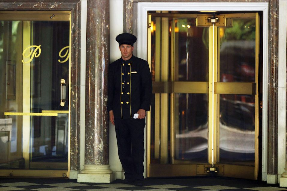 A doorman stands in front of the Pierre Hotel