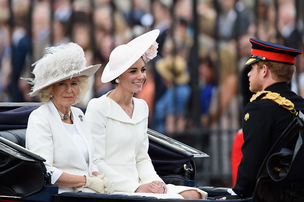 Camilla, Duchess of Cornwall, Catherine, Duchess of Cambridge and Prince Harry sit in a carriage during the Trooping the Colour, this year marking the Queen's 90th birthday at The Mall