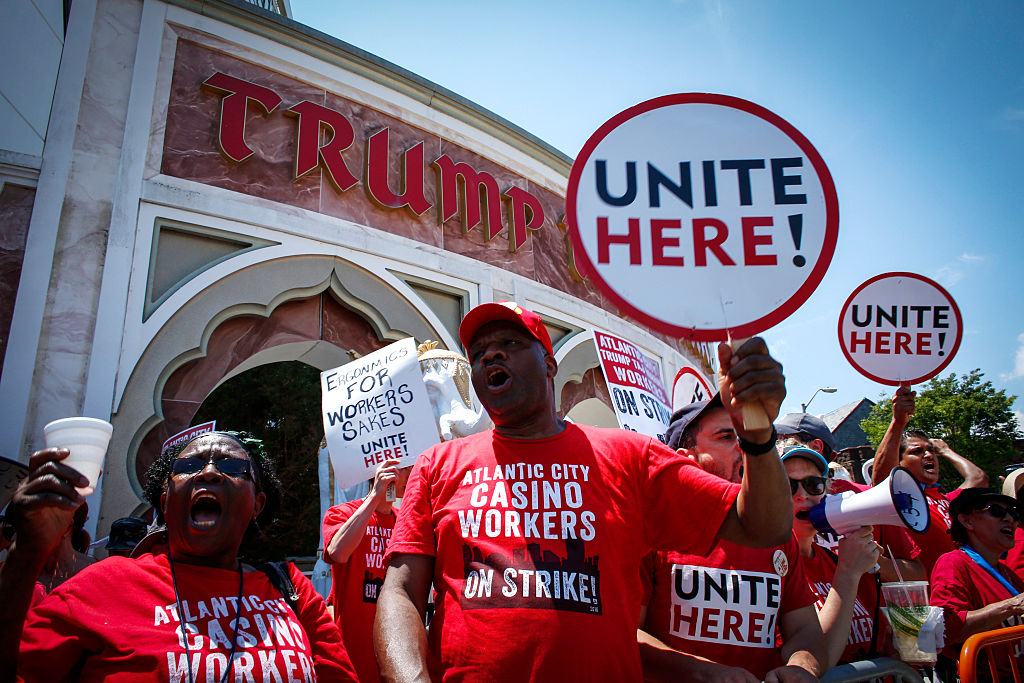 Union workers from local 54 take part in a rally outside the Trump Taj Mahal in Atlantic City