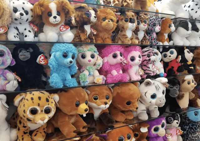 Beanie Babies stacked in a store.