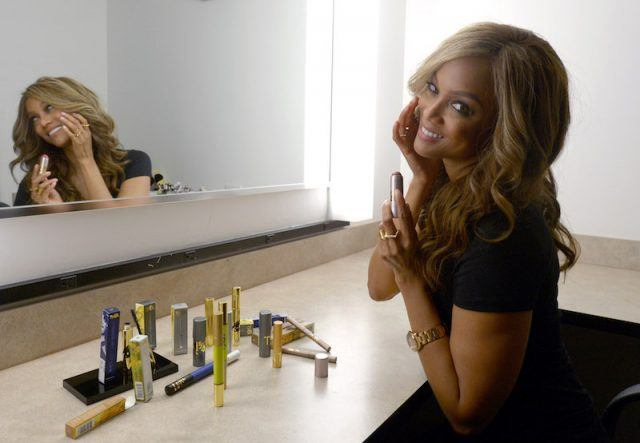 Tyra Banks showing her beauty products.