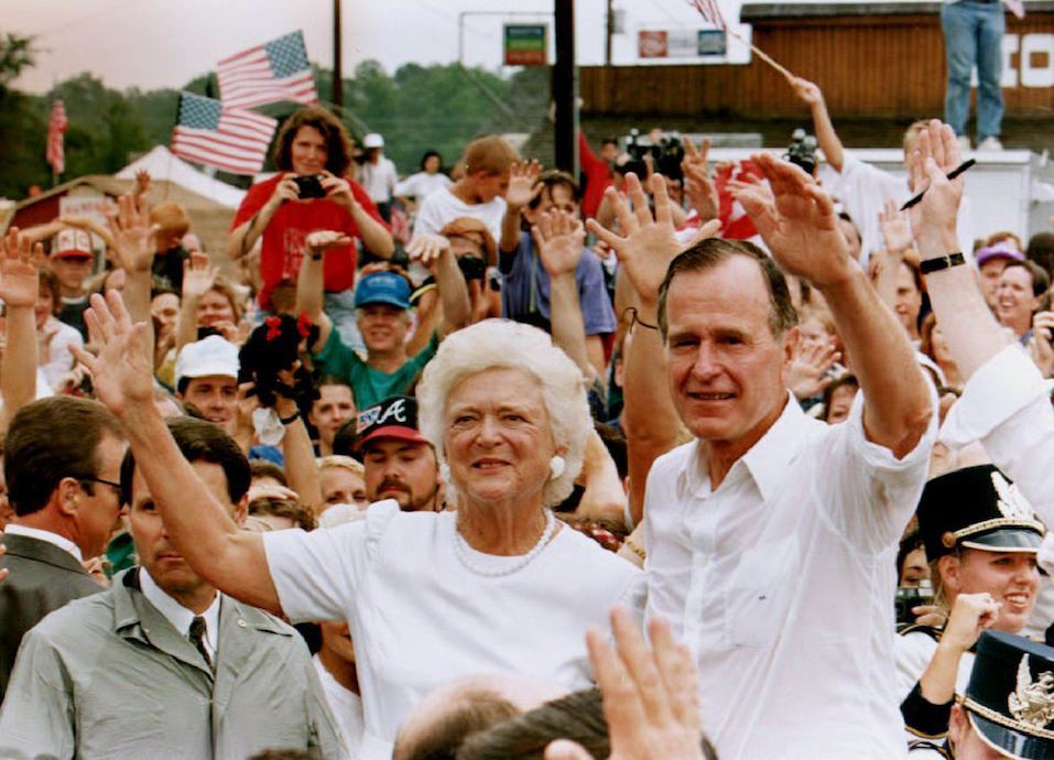 U.S. President George Bush and wife, Barbara, wave to a crowd of supporters