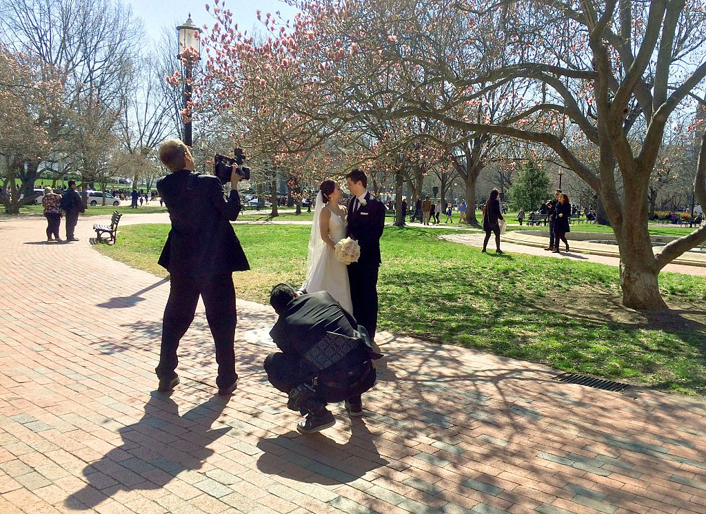 A couple has their wedding photos taken in Lafayette Park across from the White House i
