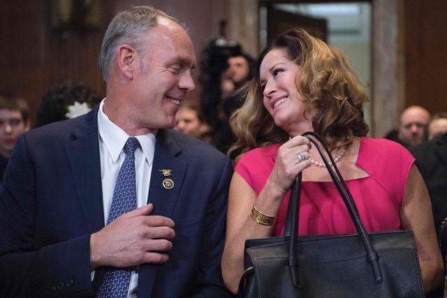 US Congressman Ryan Zinke R-Montana, smiles at his wife Lolita Hand as he prepares to testify before Senate Committee on Energy and Natural Resources on Capitol Hill