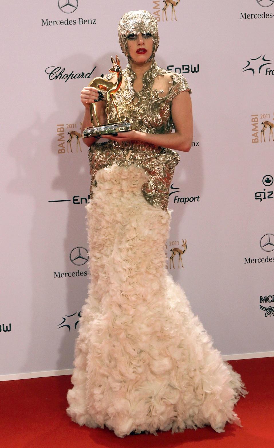 US singer Lady Gaga poses with her International Pop award