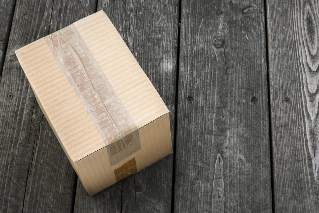 unmarked package being delivered