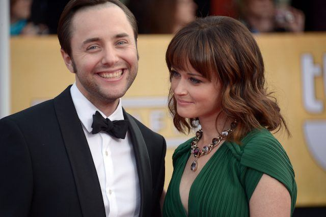 Vincent Kartheiser and Alexis Bledel posing for the paparazzi on a red carpet.