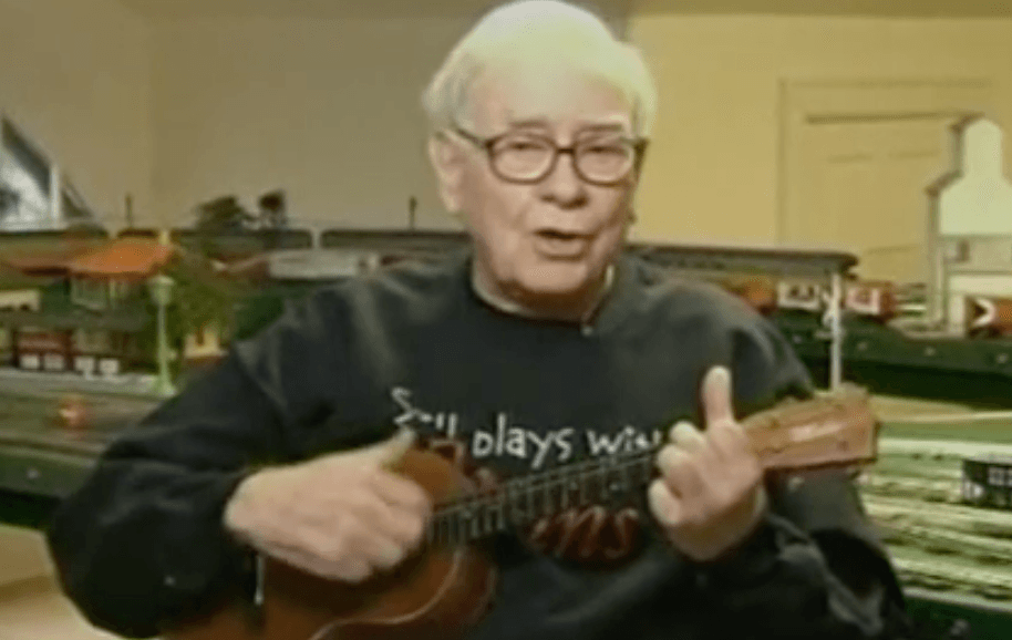 Warren Buffett playing the ukulele