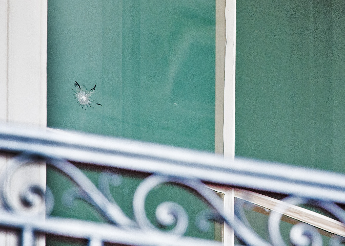 The bullet hole in the window at the White House