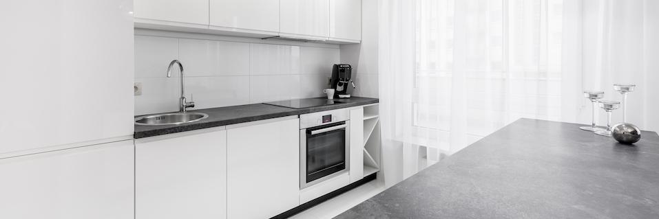 Granite countertop in contemporary white kitchen