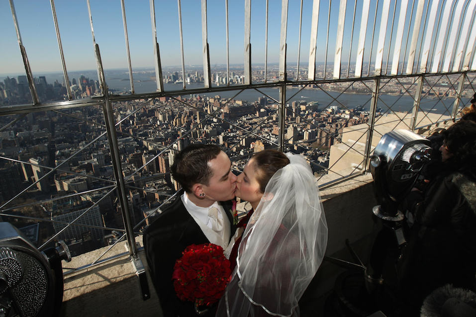 Whitney Edwards and Tim Randall kiss on the 86th Floor Observatory of the Empire State Building