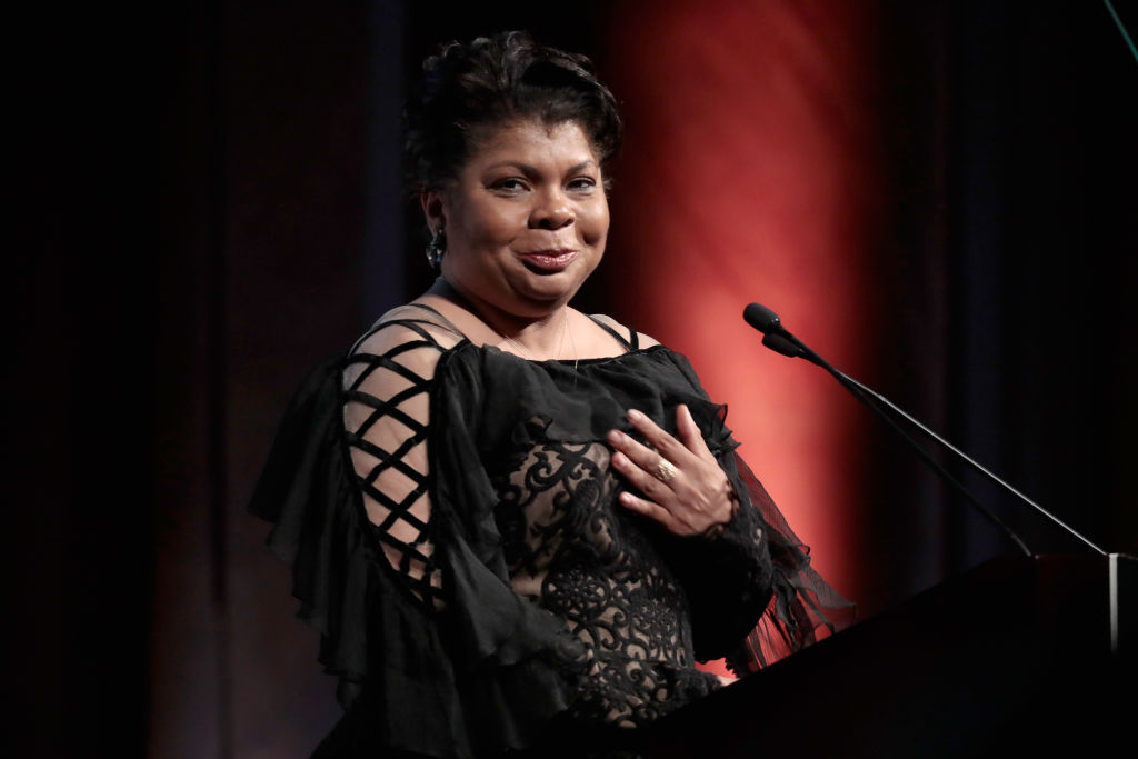 Journalist April Ryan accepts the WMC She Persisted Award onstage