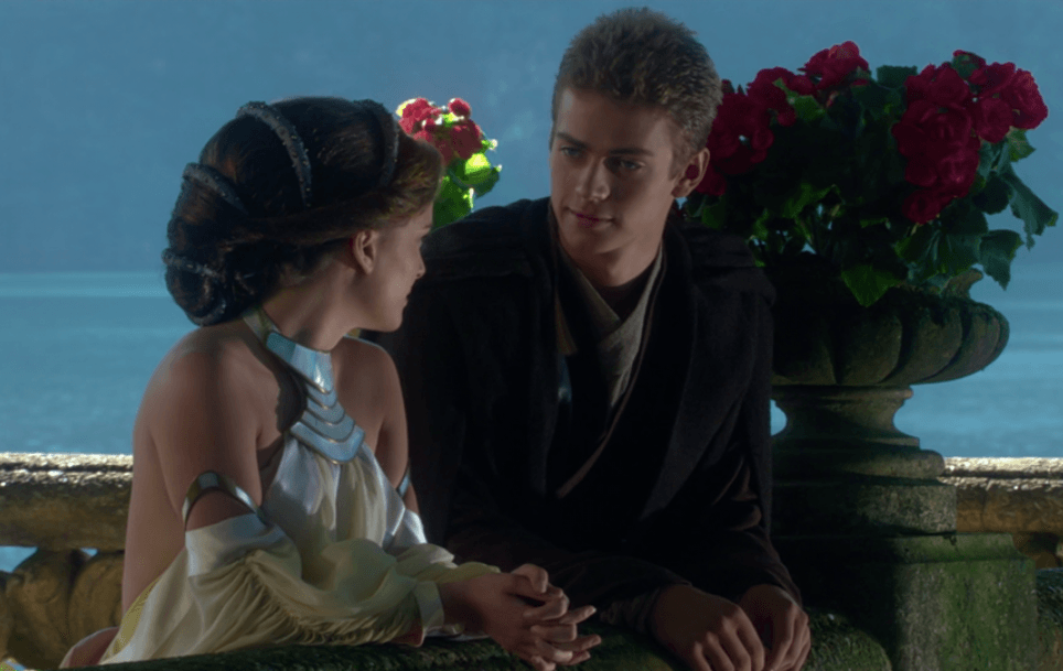 Anakin sits with Padme near the ocean.