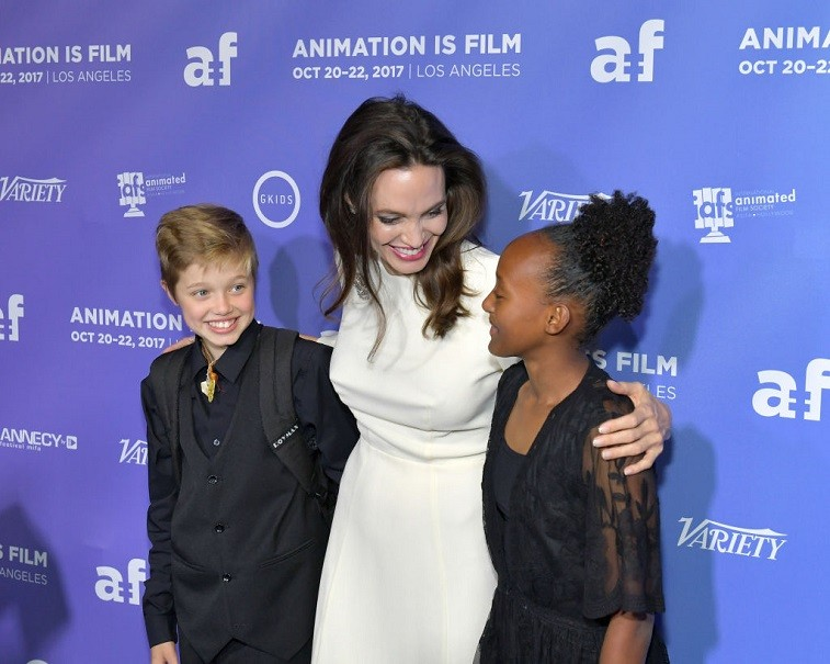 """Angelina Jolie and her daughters, Shiloh and Zahara, attend the Premiere Of Gkids' """"The Breadwinner"""" at TCL Chinese 6 Theatres on October 20, 2017 in Hollywood, California."""