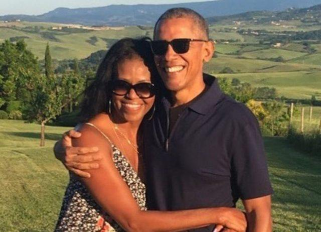 Barack and Michelle Obama posing and smiling