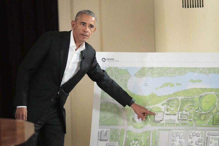 Former President Barack Obama points out features of the proposed Obama Presidential Center, which is scheduled to be built in nearby Jackson Park, during a gathering at the South Shore Cultural Center on May 3, 2017 in Chicago, Illinois.