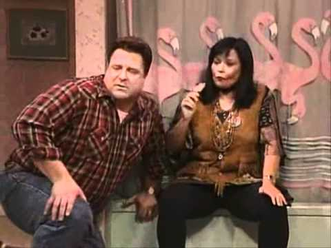 Dan and Roseanne sit on the edge of a bathtub