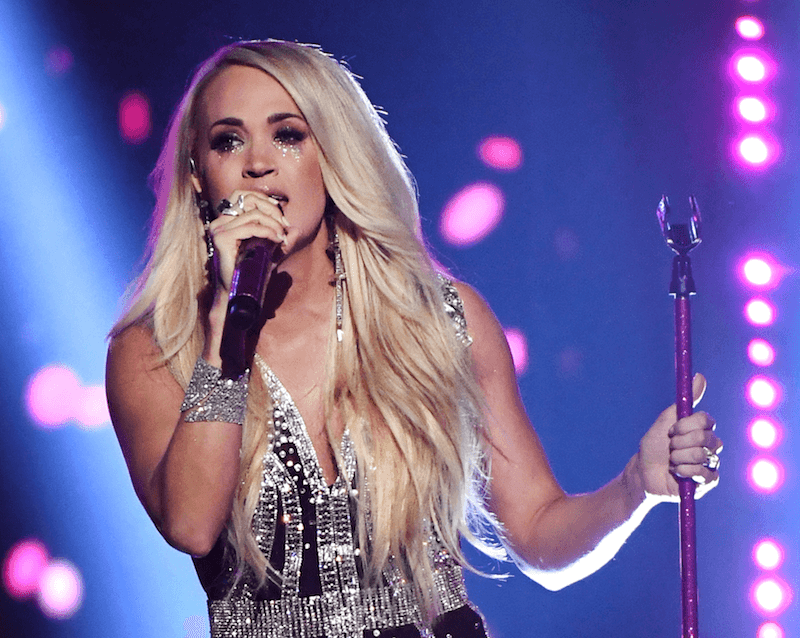 Carrie Underwood holding a mic