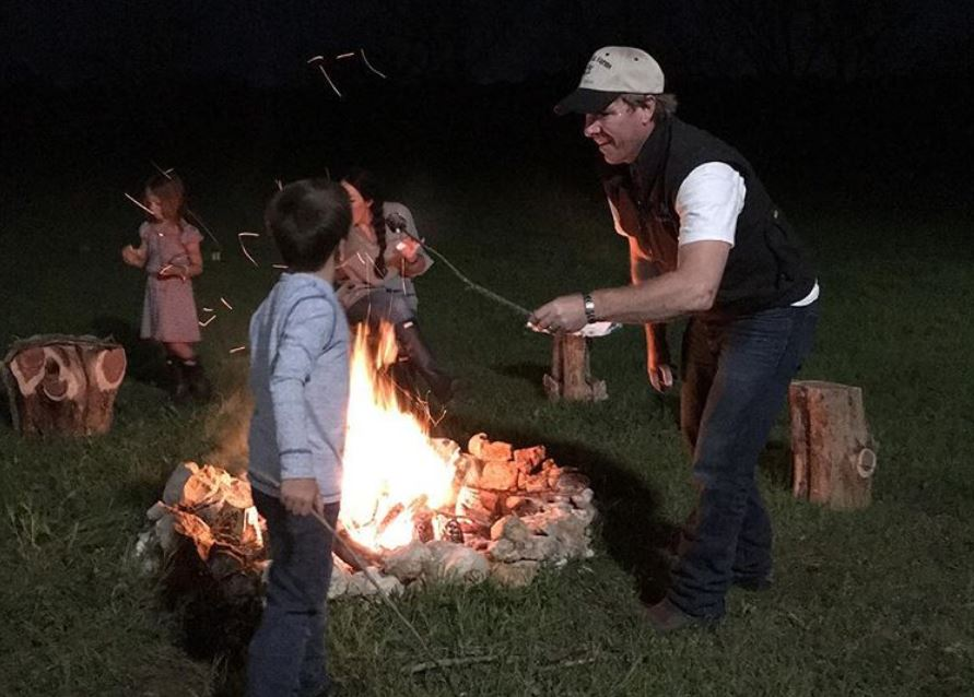 Chip Gaines and his kids around a campfire