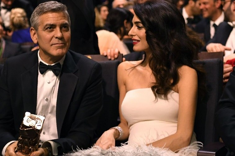US actor George Clooney and his British-Lebanese lawyer Amal Clooney speak during the 42nd edition of the Cesar Ceremony at the Salle Pleyel in Paris on February 24, 2017.